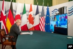 برطانیہ کے وزیراعظم بورس جانس جی سیون ورچوئل اجلاس کی صدارت کر رہے ہیں۔ 19 فروری 2021
