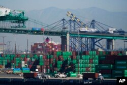 Containers are stacked at the Port of Los Angeles in Los Angeles, Oct. 1, 2021.