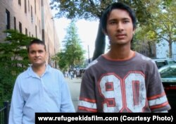 Tek Nath and his father, refugees from Nepal.