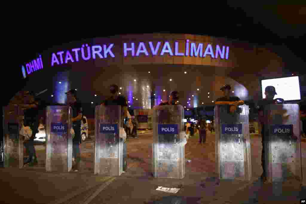 Turkish police block the entrance to Istanbul's Ataturk airport early Wednesday, June 29, 2016.