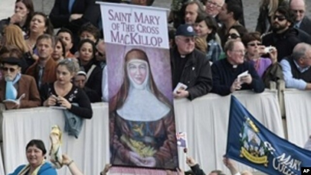 Faithful hold a banner of Saint Mary of the Cross MacKillop, of Australia, during a Canonization Mass celebrated by Pope Benedict XVI in St. Peter's square at the Vatican, Sunday, Oct. 17, 2010