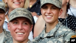 U.S. Army 1st Lt. Shaye Haver, left, and Capt. Kristen Griest pose for photos with other female West Point alumni after Ranger school graduation at Fort Benning, Ga., Aug. 21, 2015.