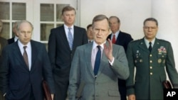 FILE - In this Feb. 11, 1991, file photo, President George H.W. Bush talks to reporters in the Rose Garden of the White House after meeting with top military advisors to discuss the Persian Gulf War.