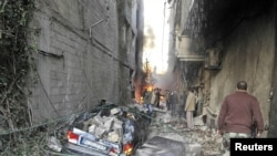 Explosions Rip Through Damascus Suburb