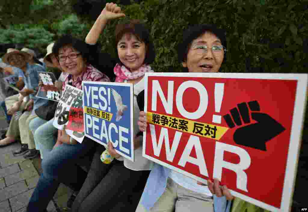 People hold placards during an anti-government rally near Prime Minister Shinzo Abe's official residence in Tokyo, Japan. On the 70th anniversary of the end of World War II Abe expressed deep remorse over the war.