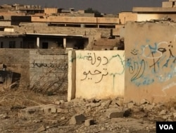 "In this village once controlled by Islamic State militants, graffiti mocks IS, roughly calling it ""Epic Fail State"", in Hassan Sham, Kurdistan, Iraq, Oct. 21, 2016. (Photo: H. Murdock / VOA)"