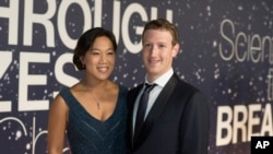 Priscilla Chan and Mark Zuckerberg arrive at the 2nd Annual Breakthrough Prize Award Ceremony at the NASA Ames Research Center on Sunday, Nov. 9, 2014.