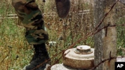 A Lebanese soldier steps over a landmine. (file)
