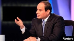 FILE- Presidential candidate and Egypt's former army chief Abdel Fattah el-Sissi talks during a television interview broadcast on CBC and ONTV, in Cairo, May 6, 2014.