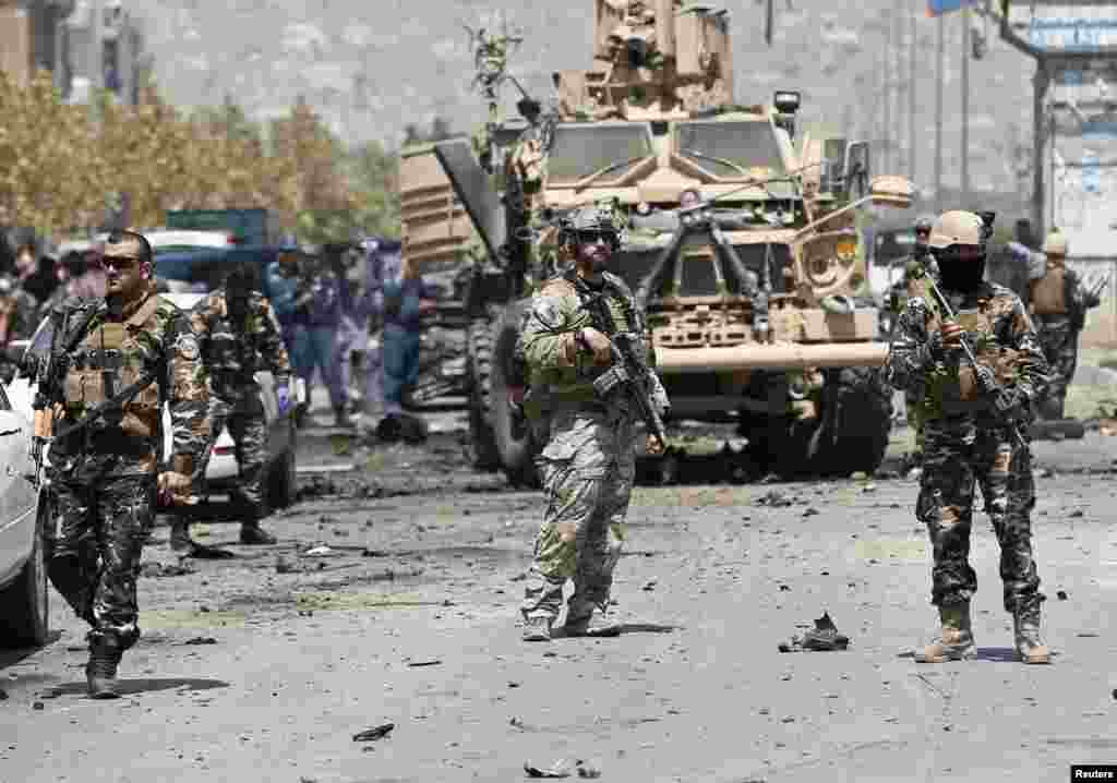 NATO troops arrive at the site of a suicide car bomb attack in Kabul. A suicide car bomber targeted a convoy of foreign forces in the capital, killing at least four Afghan civilians, including children, and wounding dozens, Afghan security officials said.