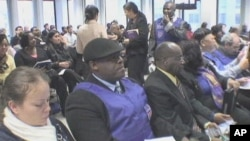 Haitian immigrants learn about a new immigration program for Haitians living in the United States at the Federal Building in Manhattan, New York
