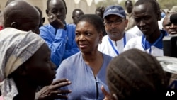 United Nations Under-Secretary-General for Humanitarian Affairs and Emergency Relief Coordinator for South Sudan, Valerie Amos, engages with local government officials and humanitarian aid workers in the village of Walgak, South Sudan on Thursday, Feb. 2,
