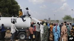 Residents gather outside UNMIS sector headquarters in Kadugli town, Sudan, June 9, 2011.