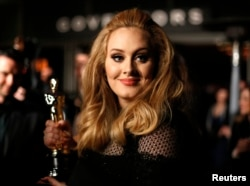 """FILE - Singer Adele, winner of the Oscar for best original song for """"Skyfall,"""" is interviewed at the Governors Ball for the 85th Academy Awards in Hollywood, California."""