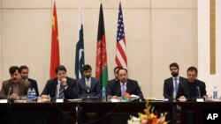 Afghan Foreign Minister, Salahuddin Rabbani, center, starts the meeting to discus a road map for ending the war with the Taliban at the Presidential Palace in Kabul, Afghanistan, Feb. 23, 2016.