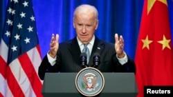 U.S Vice President Joe Biden gives a speech during his joint business leader breakfast at The St. Regis Beijing hotel in Beijing, Dec. 5, 2013.