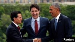 """""""La integración de la economía nacional en la economía mundial existe, es un hecho"""", dijo Obama en una rueda de prensa al final de la cumbre de """"Los Tres Amigos""""."""