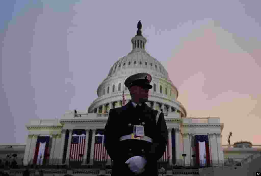 A ceremonial Coast Guard honor guard stands in front of the U.S. Capitol before the ceremonial swearing-in of President Barack Obama during the 57th Presidential Inauguration in Washington, Monday, Jan. 21, 2013