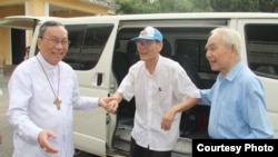 In this photo released by the Hue Archdiocese, Father Nguyen Van Ly returns home after his release from prison.