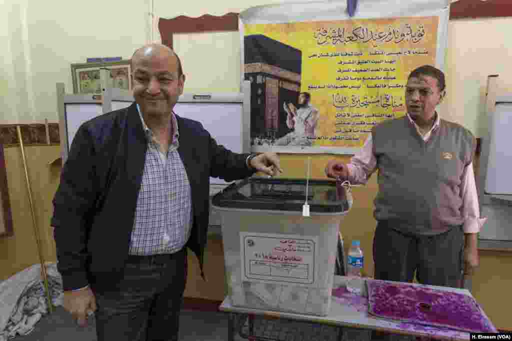 In a bid to counter criticism from those who questioned the elections' legitimacy, officials urged voters to turn out in large numbers. Joining the publicity effort, TV host Amru Adib cast his ballot in central Cairo and urged others to do the same, March 27, 2018.