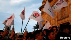 Revolutionary Alternative Force of the Common (FARC) Political party flags are seen during a protest in support of the Special Jurisdiction for Peace (JEP) in Bogota, Colombia, March 13, 2019.