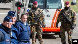 Belgian policemen and soldiers secure the area outside Zaventem Airport in Brussels, Tuesday, March 29, 2016. Tuesday, airport authorities inspected the construction and fire safety of the temporary constructions and airport staff tested the temporary arrangements and infrastructure for the check-in procedure. (AP Photo/Geert Vanden Wijngaert)