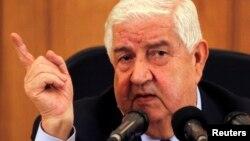 Ngoại trưởng Syria Walid Moualem nói chuyện tại một cuộc họp báo, 27/8/13