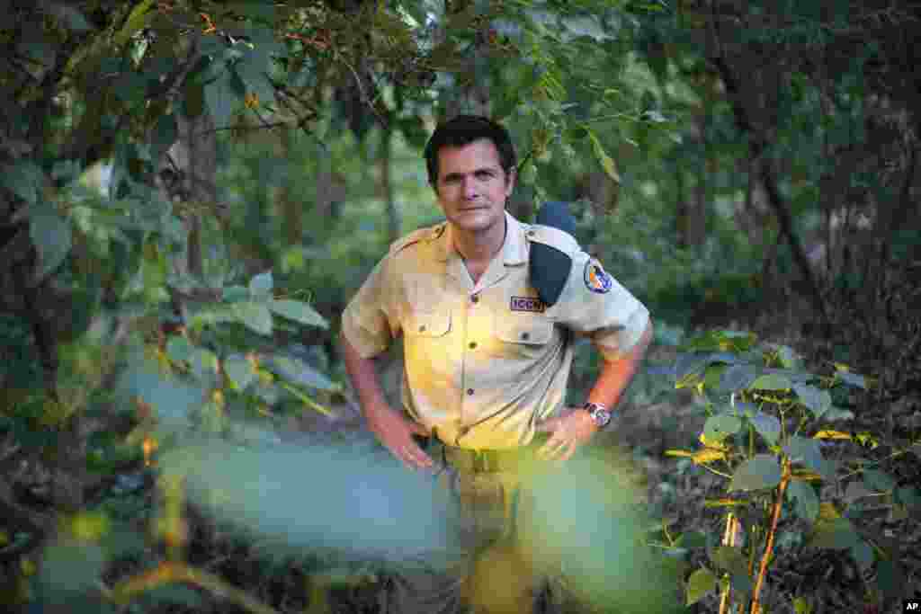 The director of Virunga National Park, Emmanuel de Merode, recently recovered from being shot four times in the chest by gunmen. He believes the park will be central to the economic recovery of the entire region which has been devastated by two decades of militia violence. He posed in the park in 2013 for this photograph.