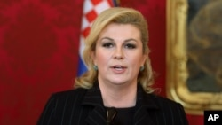 FILE - Croatia's President Kolinda Grabar-Kitarovic addresses the media after her talks with Austrian President Heinz Fischer at the Hofburg palace in Vienna, Austria, June 18, 2015.