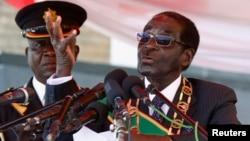 Zimbabwe's President Robert Mugabe addresses the crowd gathered to commemorate Heroes Day, in Harare, Zimbabwe, Aug. 12, 2013.