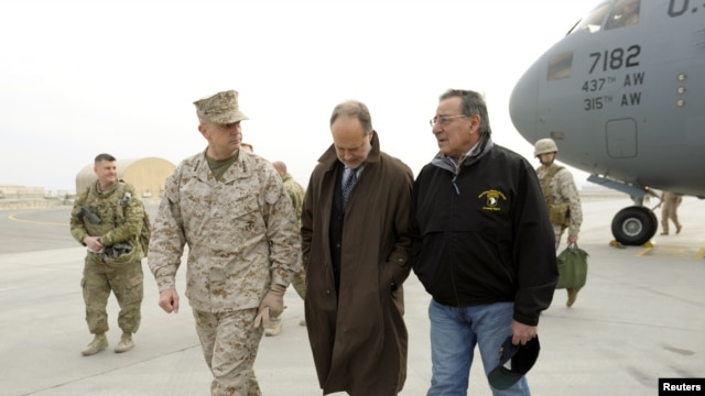 Defense Secretary Leon Panetta (R) talks with U.S. Ambassador to Afghanistan James B. Cunningham (C) and Marine General John R. Allen, commander of International Security Assistance Force, upon arriving at Kabul International Airport, December 12, 2012.