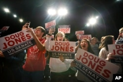 "Supporters of Democratic senatorial candidate Doug Jones cheer as he comes onstage before he speaks during a ""get out the vote rally,"" Dec. 9, 2017, in Birmingham, Ala."