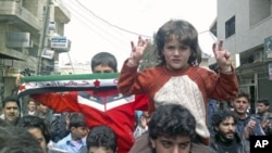 Demonstrators protest against Syria's President Bashar al-Assad in Kafranbel, near Idlib, Syria, April 1, 2012.