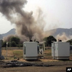 A huge explosion is seen near a United Nations compound in South Kordofan state, June 14, 2011