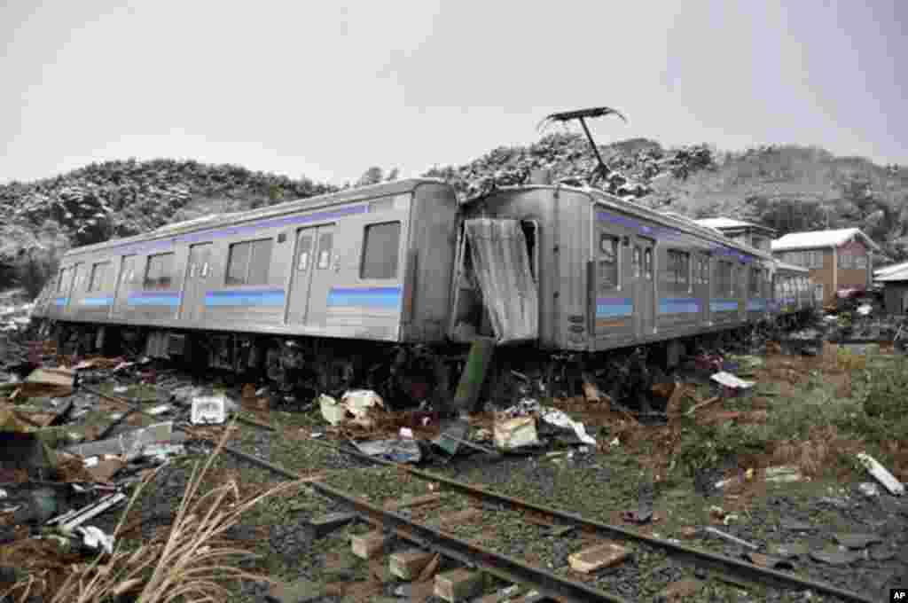A damaged train is seen after an earthquake and tsunami in Matsushima City, Miyagi Prefecture. (Reuters Image)