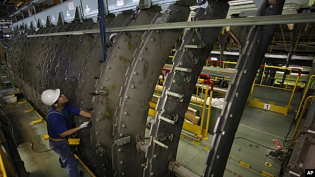 An employee works on a jig for a Boeing 767 at Mitsubishi Heavy Industries' Tobishima plant of its Nagoya Aerospace Systems Works in Nagoya, central Japan September 22, 2010.