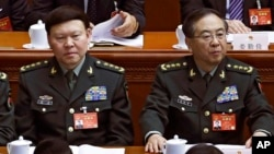 In this March 8, 2017, photo, Zhang Yang, left, the then-head of China's People's Liberation Army (PLA) political affairs department, is seen with Fang Fenghui, right, the then-chief of the general staff of the Chinese People's Liberation Army.