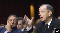 9月22號美國防部長帕內塔(左)和美軍參謀長聯席會議主席馬倫在國會參議院武裝部隊委員會聽證會上
