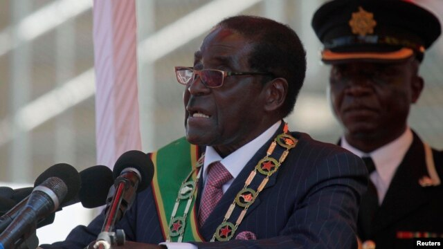 Zimbabwe's President Robert Mugabe addresses supporters during celebrations to mark the country's Defense Forces Day, in the capital Harare, Aug. 13, 2013.