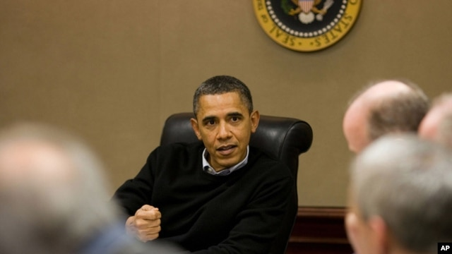 President Barack Obama is briefed on the events in Egypt during a meeting with his national security team in the Situation Room of the White House.