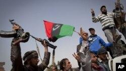 Des rebelles après avoir repris le controle d'Ajdabiya, Samedi 26 mars 2011