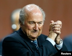 FILE - FIFA President Sepp Blatter gestures after he was re-elected at the 65th FIFA Congress in Zurich, Switzerland, May 29, 2015.