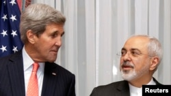 U.S. Secretary of State John Kerry, left, and Iran's Foreign Minister Mohammad Javad Zarif are seen before resuming talks over Iran's nuclear programme in Lausanne, Switzerland, March 16, 2015.