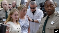 Mecklenburg County Sheriff's Deputies in North Carolina escort the family of Charlotte-Mecklenburg Police Officer Randall Kerrick from the courthouse following a mistrial in the Kerrick's trial, in Charlotte, N.C., Aug. 21, 2015.