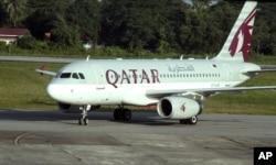 FILE - A Qatar Airways plane sits on the tarmac at Yangon International Airport in Yangon, Myanmar, Oct. 4, 2012.