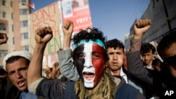 FILE - A Houthi Shi'ite rebel with Yemen's flag painted on his face chants slogans during a rally in the capital, Sana'a. (File)