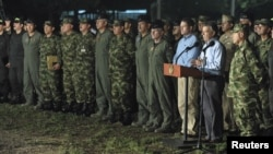 Colombia's President Juan Manuel Santos (2nd R) speaks after a meeting with military high command officers.