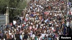 예멘 대통령과 내각이 총사퇴를 선언한 가운데 수도 사나에서 24일 후티 반군에 반대하는 시위대의 모습.