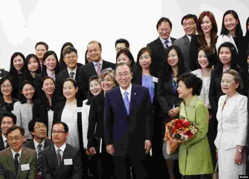 U.N. Secretary-General Ban Ki-moon and South Korean President Park Geun-hye pose for a photo with staff members at U.N. headquarters in New York, May 6, 2013.