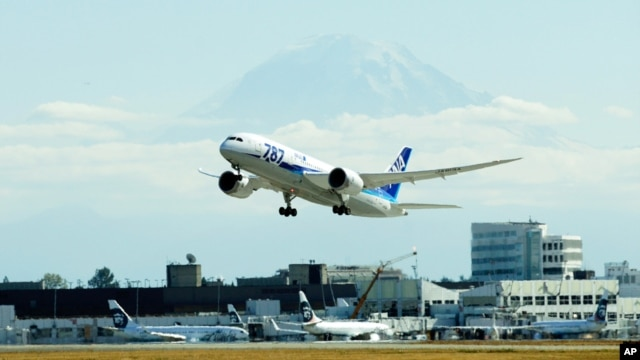 FILE - The first scheduled Boeing 787 airplane to depart from Seattle-Tacoma International Airport, takes off October 2, 2012.